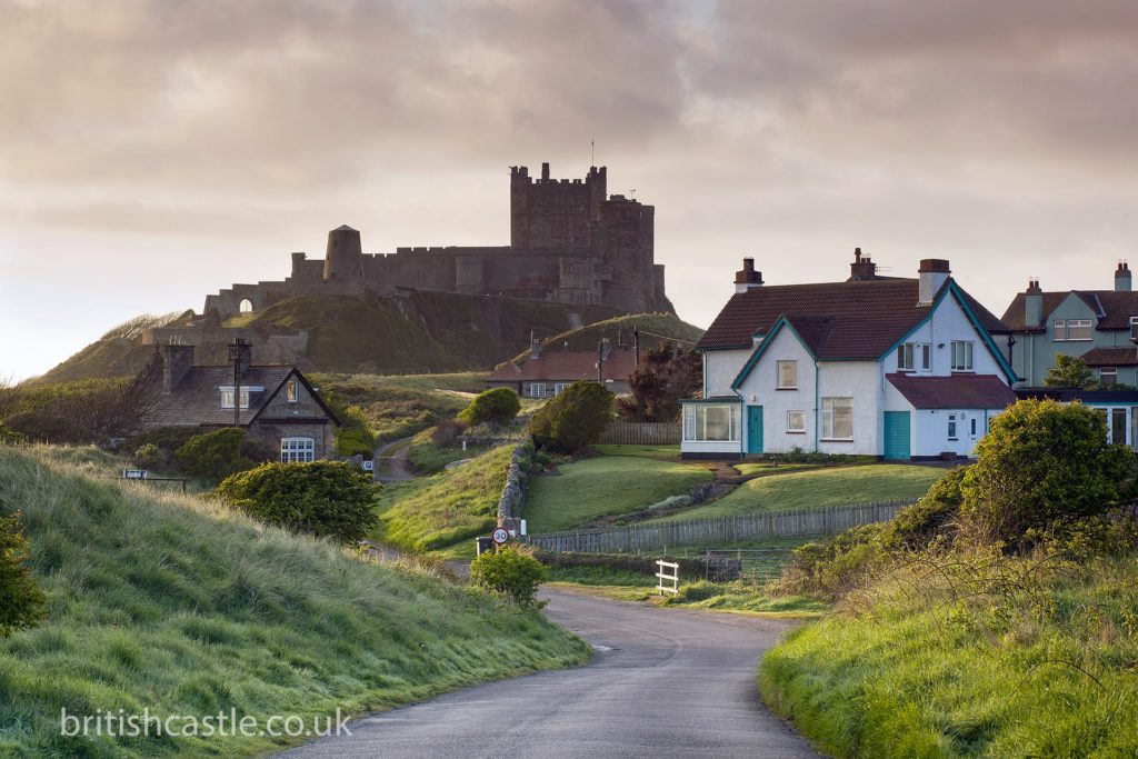 Bamburgh castle looms over the village